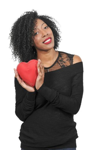 Beautiful young woman holding a Valentines Day heart