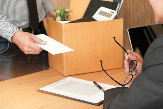 Business man sending resignation letter to boss and Holding Stuf