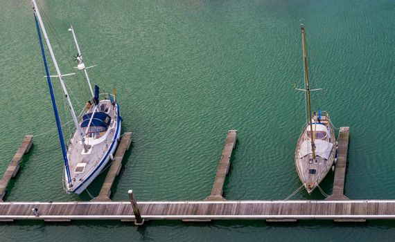 Harbor docks in Vlissingen with two typical dutch boats, Zeeland, the Netherlands