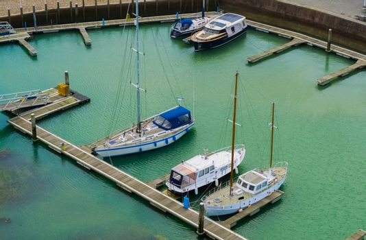 beautiful view on the docks of Vlissingen, typical dutch boats in the harbor, Zeeland, the Netherlands