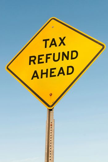 Road sign announcing that a tax refund is ahead