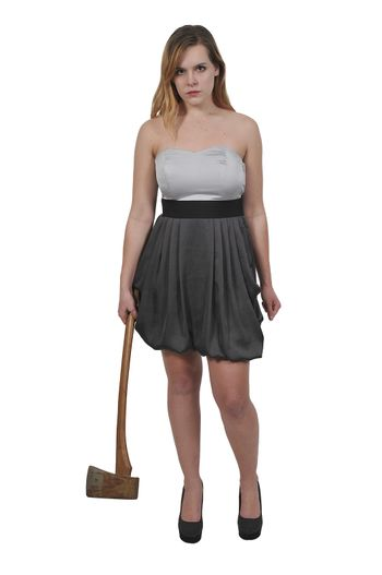 Beautiful young woman holding an wooden handled axe