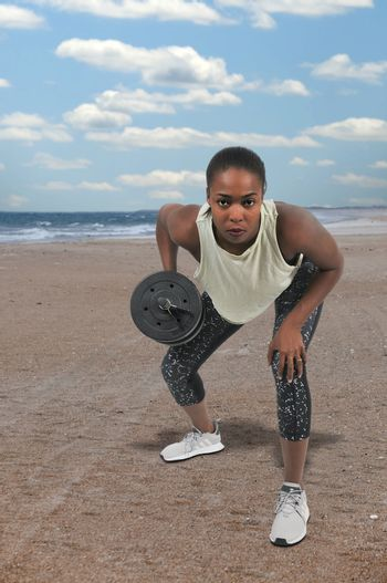 Young woman using weights during a workout