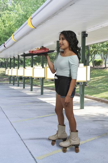 Woman food service worker server or waitress on roller skates