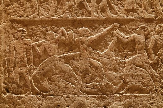 Stone wall with carved ancient Egyptian bas relief