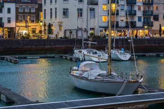 cityscape of the docks of Vlissingen, Decorated boat with lights, popular city in Zeeland at night, the Netherlands