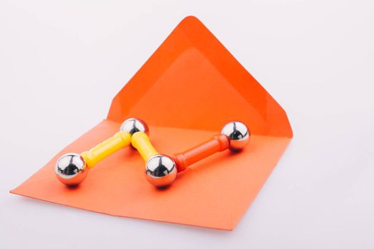 Magnet toy bars and magnetic balls on  red envelope