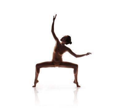 young beautiful dancer in beige swimsuit posing