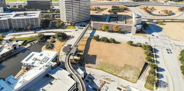 Panorama aerial view downtown Las Colinas, Irving, Texas and light rail system (Area Personal Transit, APT). Las Colinas is an upscale, developed area in the Dallas suburb
