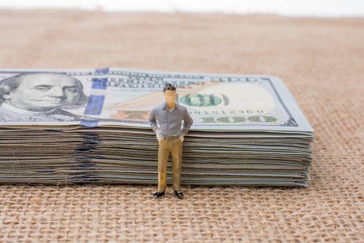 Man figurine found beside the bundle of US dollar banknote
