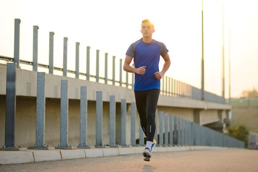 Young Sports Man Running at Sunset. Healthy Lifestyle and Sport Concept.