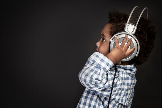 Little baby boy in headphones