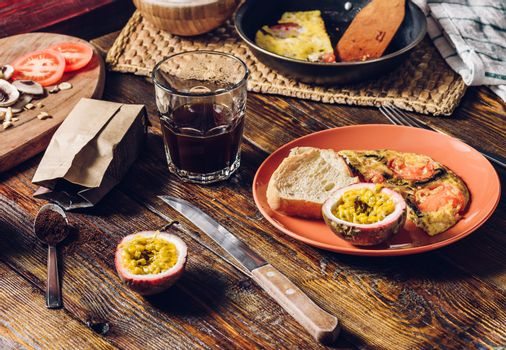 Coffee, Omelette and Granadilla for Breakfast