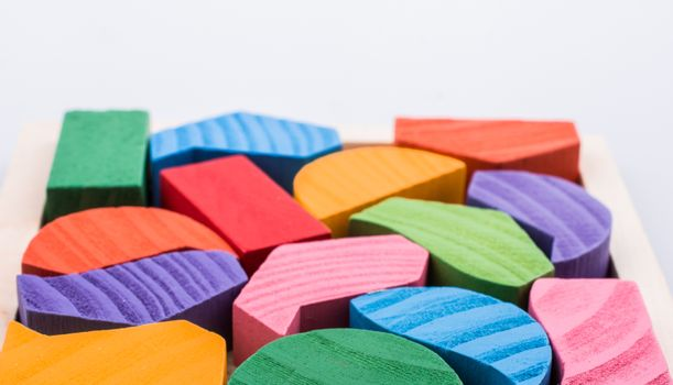 Colorful wooden pieces of a logic puzzle
