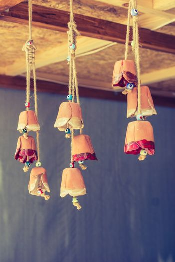 A bunch of colorful miniature bells hanging on display