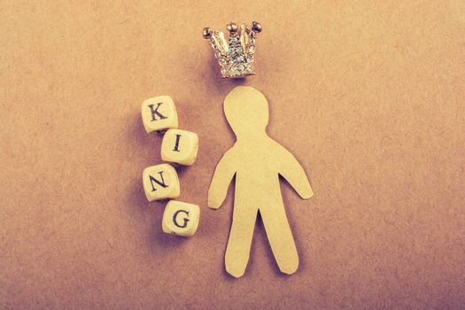 Tiny model crown beside the king wording on brown