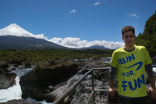 a handsome model standing over a volcano