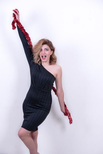 blonde attractive woman in red tinsel