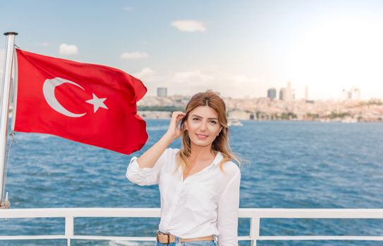 Beautiful woman travels with ferry between Asia and Europe
