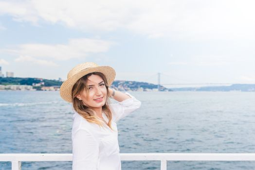 Beautiful woman travels with a ferry in Istanbul