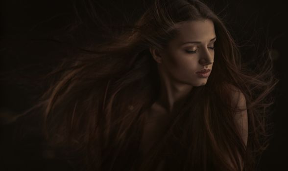 Portrait of Beautiful Woman with Long Hair