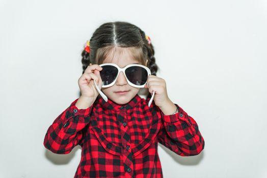 Lovely little girl wears fashion eyeglasses