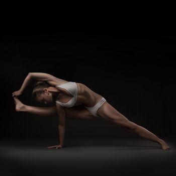 studio shoot of healthy latino woman doing yoga isolated