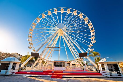 Giant Ferris wheel in Antibes colorful view, landmarks of French riviera, Alpes Maritimes department of France
