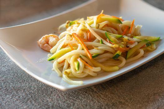 Yaki udon on white plate