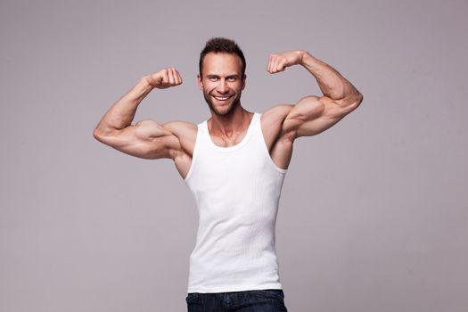 Portrait of athletic man in white undershirt