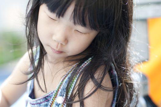Asian girl having fun in playground.