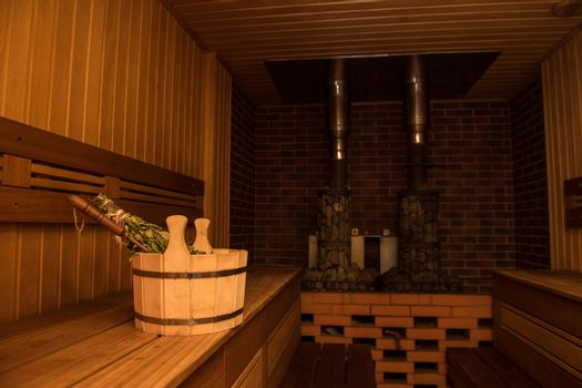 Interior of russian bath or sauna and bath accessories.