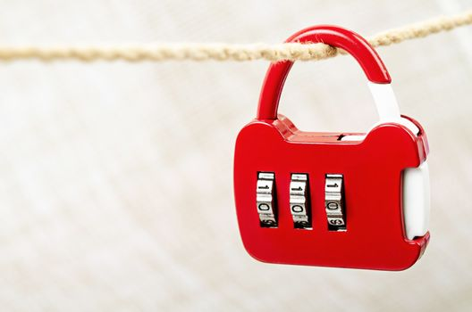 Red key lock love hanging on rope.