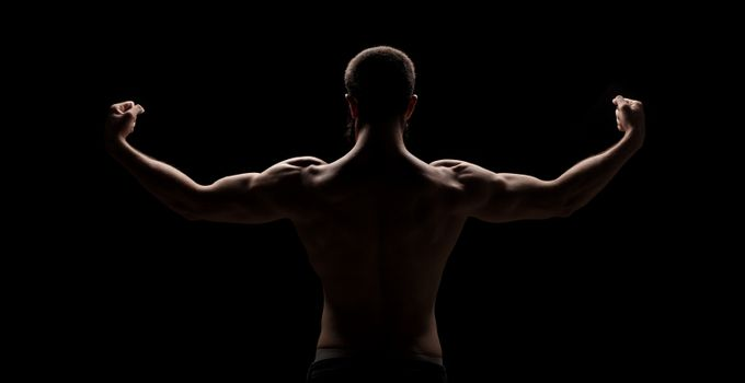 strong athletic mans back isolated