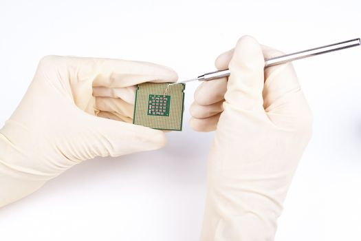 Microprocessor gold pins close-up with smd components repair