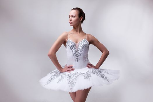 beautiful woman ballet dancer on white