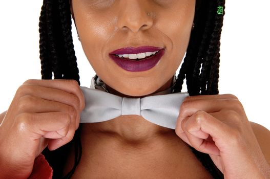 A close up image of a young woman topless and wearing a silver bow tie with black braided hair, isolated for white background