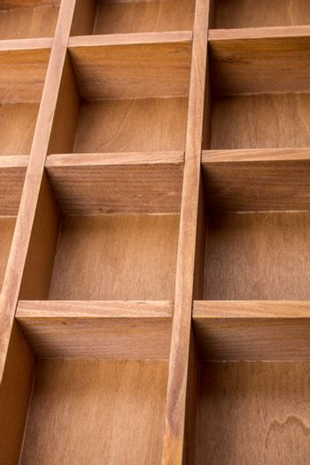 Close up of wooden box with compartments