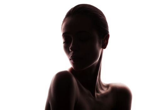 silhouette of young adult woman with clean fresh skin