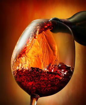 Red wine on an orange background