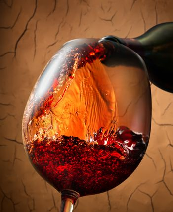 Red wine on clay background