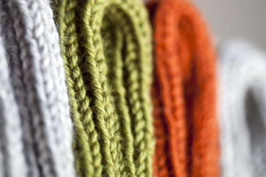 Orange, green and grey wool knitted texture