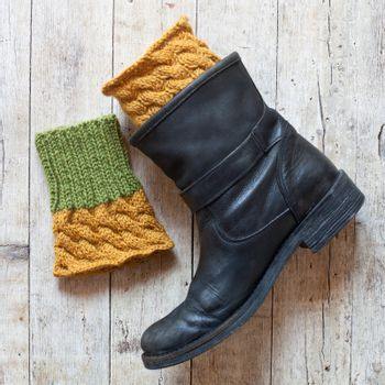 black leather boot and knitted wood legwarmers