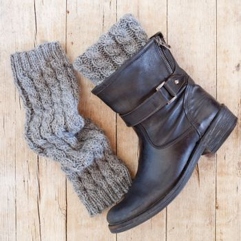 black leather boot and grey knitted wood legwarmers
