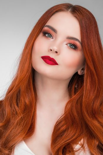 Portrait of young woman with long beautiful ginger hair
