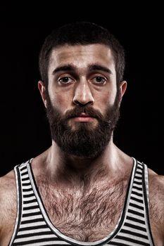 emotional Georgian in a striped shirt