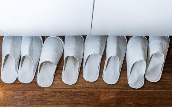 four pairs white house slipper