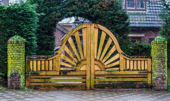 beautiful wooden garden gate with a sun pattern, modern architecture