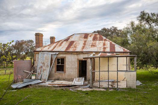 Old abandoned farm house tumbling into ruin
