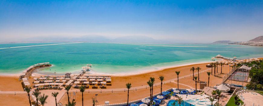 Aerial panorama view of the Dead Sea beach area of Ein Bokek resort in Israel.